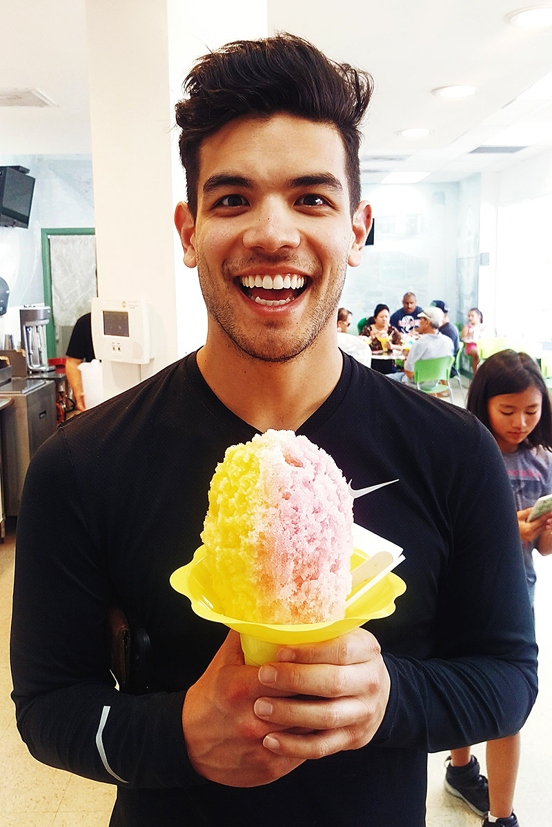 "A very happy Justin eating his ""small"" shave ice at Shimazu"