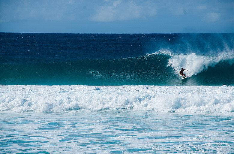 Surfers on the Banzai Pipeline at Ehukai Beach
